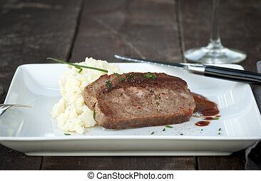 Meatloaf - Slice of homemade meat loaf with mashed potatoes...