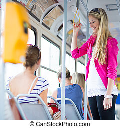 Pretty, young woman on a streetcar/tramwaystreetcar/tramway,...