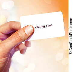 White visit card in hand on bright background