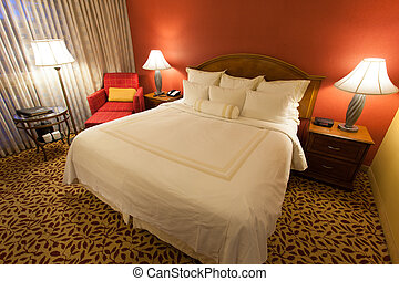 Nice hotel room with king bed, dressers, lamps, lights etc