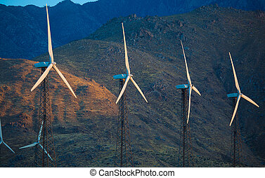 A group of wind turbines, wind mills in the dessert