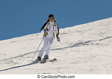 woman skiing making nice turn on slope