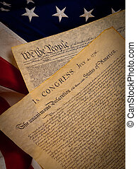 The United States Constitution and Declaration of Independence on a flag background