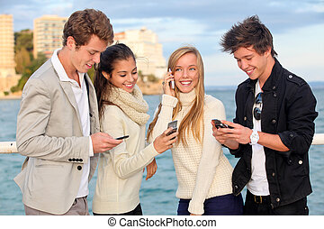young people phones - young people or couples with cell or...