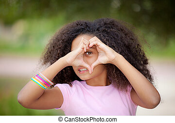 heart shape kid - young african american kid making heart...