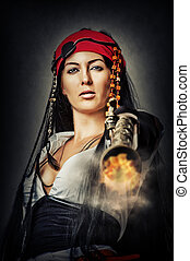 sexy female pirate shooting from gun - Portrait of sexy...