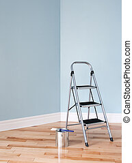 Renovation project. Ladder and a can of paint in a room -...