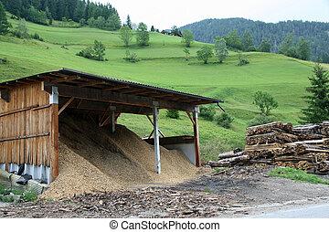 sawdust and wood of a sawmill - sawdust and wood after...