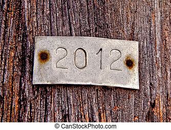The Aluminum plate of 2012 on old wood background