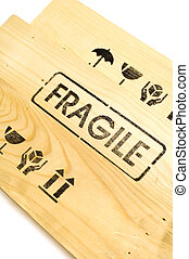 fragile sign on white - wooden crate with fragile content