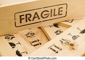 fragile sign on wood box - wooden crate with fragile content
