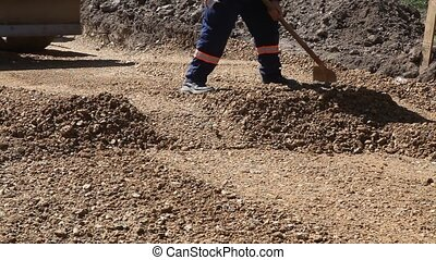Construction site - Roadworks, manual worker and motograder