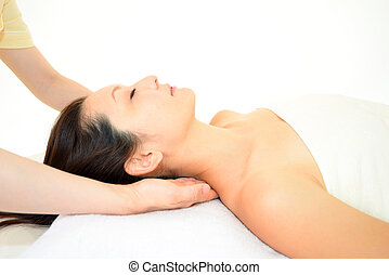 The woman has a massage to the neck in a beauty salon