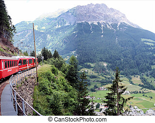 The Bernina Express - A train of the Rhaetian Railway with...