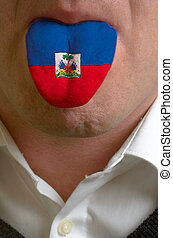 man with open mouth spreading tongue colored in haiti flag as symbol of values like teaching, learning, multilingual speaking of different languages