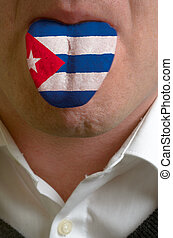 man wit open mouth spreading tongue colored in cuba flag as...