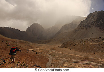 Treking To Base Camp - Three mountaineers trek toward the...