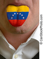 man wit open mouth spreading tongue colored in venezuela...