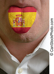 man wit open mouth spreading tongue colored in spain flag as...