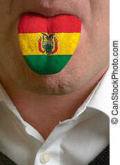 man wit open mouth spreading tongue colored in bolivia flag...