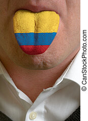 man with open mouth spreading tongue colored in colombia...