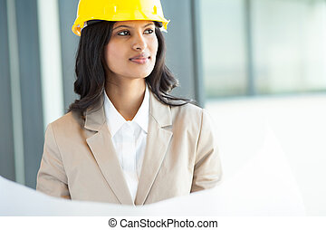 beautiful young indian architect in office