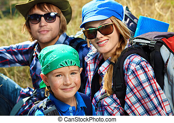 family hobby - Happy parents hiking with their little son.