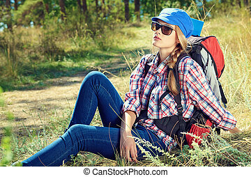 adventure - Beautiful girl tourist making her journey at the...