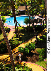 Garden landscaping at tropical resort - Swimming pool and...
