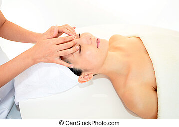 Woman receiving facial massage
