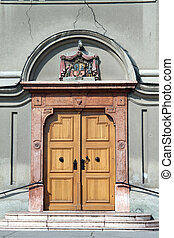 Wooden door of stone church in Subotica, Serbia