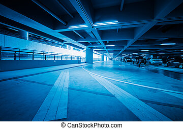 traffic in car park with blue toned in shanghai airport...