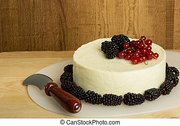 Round of fresh cheese decorated with berries