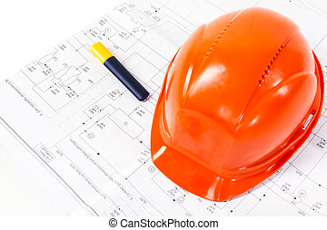 Architectural drawings and orange construction helmet on white background