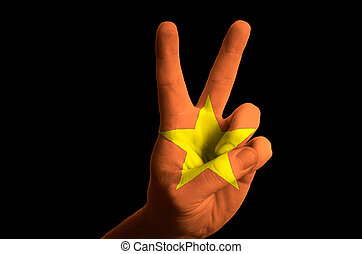vietnam national flag two finger up gesture for victory and winn