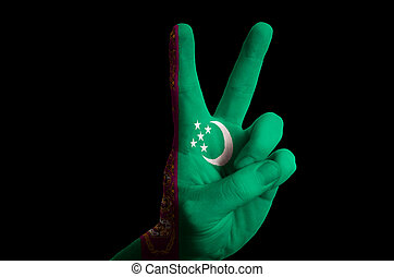 turkmenistan national flag two finger up gesture for victory and