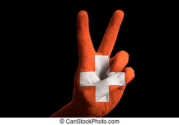 switzerland national flag two finger up gesture for victory and