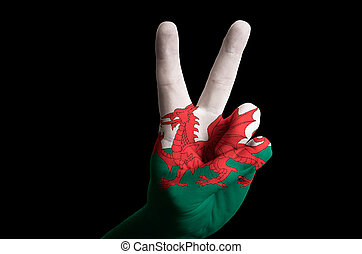 wales national flag two finger up gesture for victory and winner