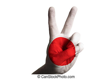 japan national flag two finger up gesture for victory and winner