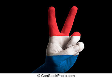 netherlands national flag two finger up gesture for victory and