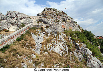 Stone wall - Long stone wall on the top of rock in Knin,...