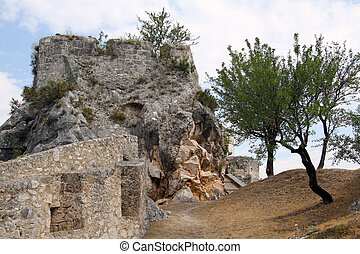 Stona wall and rock - Stone wall and rock inside fortress in...
