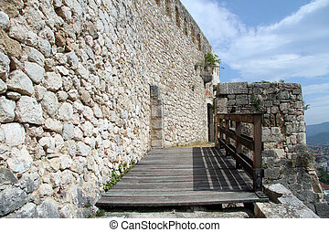 Bridge and wall - Wooden bridge and wall of fortress in...