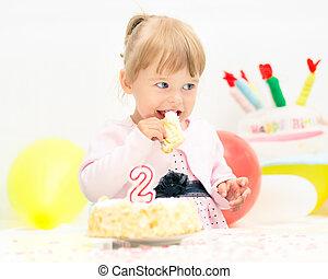 Little girl celebrating second birthday - Little girl...