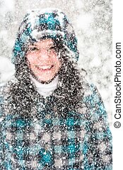 Photo of a young woman in the snow