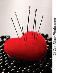 Revenge of a woman - Macro shoot of a red heart siiting on...