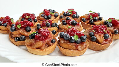 Sweet dessert with apples blueberries and cranberries