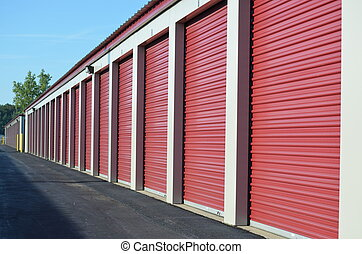 Storage Unit Doors - A line uniform line of storage unit...