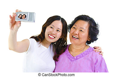 Self photographing - Asian girl and senior mother self...