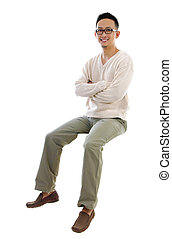 Full body Asian man sitting on a transparent block over...
